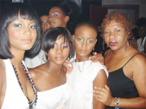 Paulla with models she made up at White Angels in Grenada.