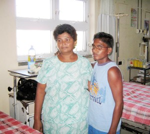 Munesh Mangal and his mother at the Georgetown Public Hospital prior to the surgery on Friday. (Photo courtesy of the Ministry of Health)