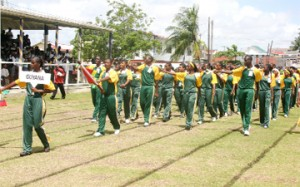 A confident-looking Guyana team marching past the main pavilion at the Eve Leary ground yesterday to a standing ovation. (Orlando Charles photo)