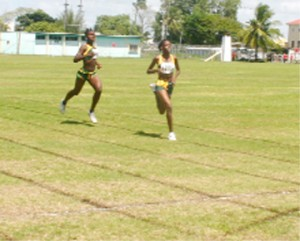 Home Alone! Guyana's Jevina Straker (R) and Janella Jonas (L) storm home unchallenged in their IGG 1500m race at the Eve Leary Sports Complex ground, yesterday. (Orlando Charles photo)