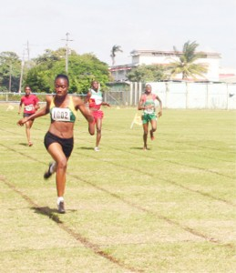Girl Power! Nadine Rodrigues (wearing 1002) approaches the finish line to take gold ahead of team-mate Roxanna Rigby (far right) in the female 200m on day two of the IGG Track and Field Championship, Suriname's Danielle Clark (2nd r) claimed bronze. (Orlando Charles Photo)