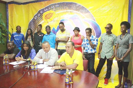 Sitting from left are Anthony Johnson, musician of the Heat Wave band; ANSA McAL Public Relations Officer, Darshanie Yussuf; Marketing Director, Troy Cadogan and Nigel Worrell, Brand Co-ordinator. In the background are nine of the 22 contestants.