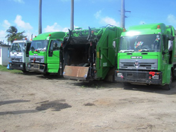 Four of the eight City Council trucks that are down at the City's Solid Waste Management Department and Municipal Mechanic Workshop. (Government Information Agency photograph)