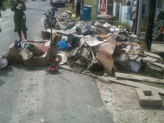 A pile of garbage appeared in Cowan Street after the flooding as residents threw out damaged items.