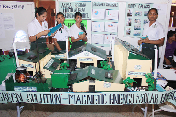 Students of Anna Regina Multilateral School displaying their project 'Green solution- magnetic energy and solar energy'