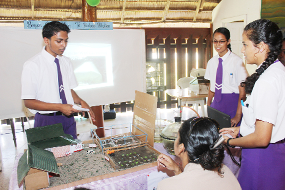 Students of President's College giving a presentation on their project 'Biogas generation from farm and kitchen waste: a clean source of fuel and electricity'