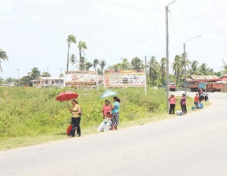 Waiting for transportation on the Leonora Public Road.