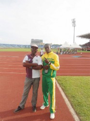 Leslain Baird (right) stands alongside his coach Robert Chisholm at the Hasely Crawford Stadium in Trinidad and Tobago.