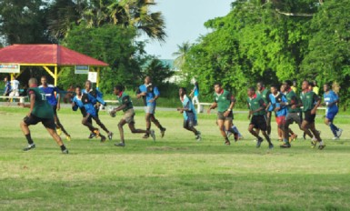National Under-19 rugby captain Godfrey Broomes (with ball) in action during a recent simulation game at the National Park Rugby field.
