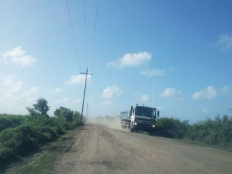The driver of this heavy-duty truck was almost flying down the Burma Road, Region 5 with not a care in the world. Some residents blame speeding by drivers of these vehicles for the rapid deterioration of the road.