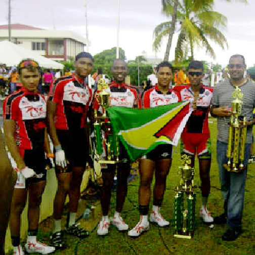 Team Coco's five-man unit (from left to right) Paul DeNobrega, Michael Anthony, Junior Niles, Christopher Holder and Raynauth Jeffrey poses with the Golden Arrowhead and their respective winnings at the completion of the 14th annual John T Memorial Road Race in Anguilla yesterday.