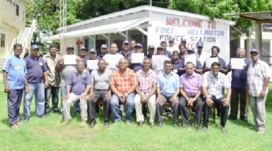 Assistant Superintendent of Police, Jairam Ramlakhan (seated, centre) poses with other officers and members of the CPGs and SMC