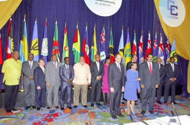 Portrait: The official photo at the conclusion of the 34th regular meeting of CARICOM Heads of Government in Trinidad and Tobago on Saturday. Also in photo are President of the Dominican Republic Danilo Medina (third from left) and Venezuelan President Nicolas Maduro (third from right) (OP/Sandra Prince photo)