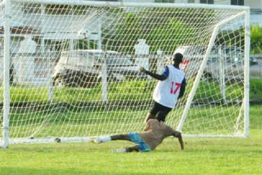 Jamal Williams (No.17) of GITC scores the first of his two goals