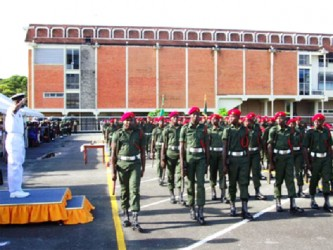 The new basic recruits march past Chief of  Staff Commodore Gary Best (GINA photo)