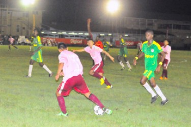 A Waramadong Secondary player battling with a Wismar/Christianburg player for possession of the ball.