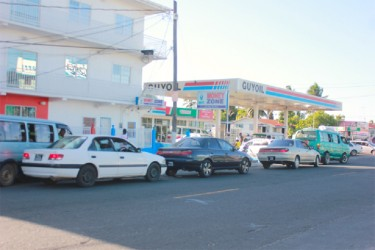 Motorists lining up at the GuyOil Gas Station on Sheriff Street to purchase gasoline.