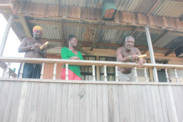 Victoria residents Winston Armstrong and his wife Carlotta along with Julian Trotman on their verandah (Arian Browne photo)