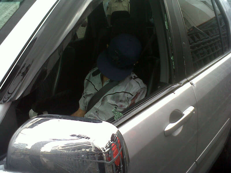 The dead man in the vehicle a few minutes after the attack