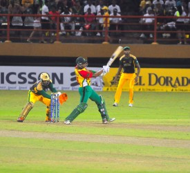 MAIN MAN! Man of-the-match Lendl Simmons smashes one of his four sixes during his unbeaten half century last night.