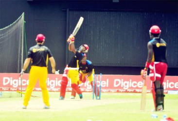 The Hawksbill team during batting sessions at the stadium yesterday
