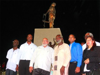 Sculptor of the 1823 monument Ivor Thom (fourth from left) flanked by President Donald Ramotar (third from left) and Culture Minister, Dr Frank Anthony