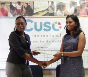 Coordinator of WAD Clonel Samuels-Boston and CUSO country representative Tara Persaud hold the agreement after yesterday's signing