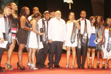 The first batch of graduates of the National School of Theatre Arts and Drama pose with President Donald Ramotar (centre) last October. (Stabroek News file photo/Arian Browne)