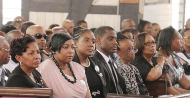 (From left) Lawrence Williams's widow Valerie, his children and relatives at his funeral service yesterday at the St George's Cathedral. (Photo by Arian Browne)
