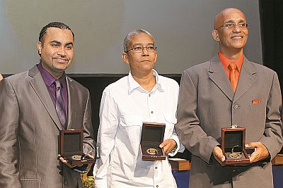 Recipients of the 2014 Anthony N Sabga Caribbean Awards For Excellence, from left, Professor Liam Teague, Karen de Souza and Dr Richard Robertson, at the awards ceremony at the National Academy for The Performing Arts (NAPA), Port-of- Spain, on Saturday evening.