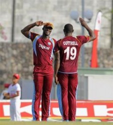 Sheldon Cottrell salutes captain Darren Sammy after taking a wicket yesterday. (Photo courtesy WICB Media)
