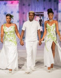 Nelsion Nurse is flanked by models wearing his designs