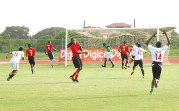 West Demerara Secondary's Jeiel Jansen (3rd from right) scoring his team's first and only goal during their hard-fought loss to L'Aventure Secondary in the Digicel Secondary School's championship yesterday at the Leonora Sports Facility. (Orlando Charles photo)
