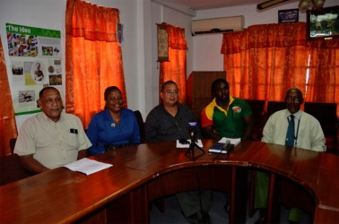 The GRFU top brass and coach of the men's national rugby team, Theo Henry (second from right) pose for a photo following yesterday's press briefing at the GOA's headquarters in Kingston