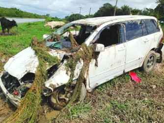 The car after it was pulled from the swollen trench in the background