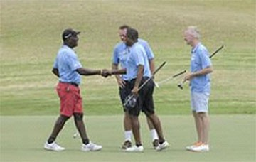Sir Viv (left) shakes hands with Cameron on the golf course