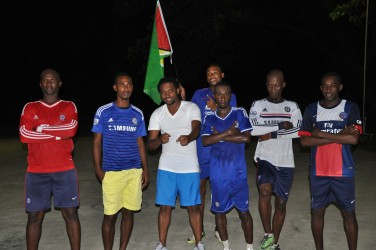 Members of Team Guyana from left to right- Jermin Weekes, Gregory Richardson, Terrence Chase-Green, Cleon Forrester (at back), Travis Grant, Sheldon Shepherd and Devon Millington posing for a photo opportunity following their last practice session prior to their departure for Jamaica