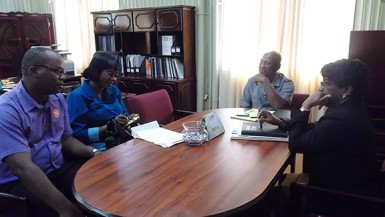 Minister Keith Scott, at head of table, with the delegation (Ministry of Communities photo)