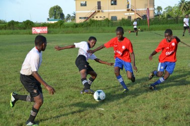 Action between Morgan Learning Centre and Tutorial Secondary at the Ministry of Education ground in the Digicel Secondary School Football Championship