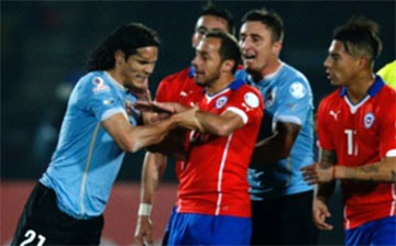 Uruguayan player Edinson Cavani clashes with Chile players following the 'finger' incident