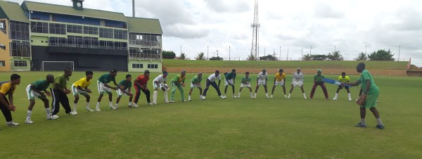 National U17 Coach Garvin Nedd doing catching drills with the team during their first day of training at the Guyana National Stadium (Clifton Ross photo)
