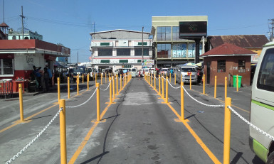The barriers demarcating the queues at the routes 46, 41 and 45 bus park, in front of the Stabroek Market, Georgetown.