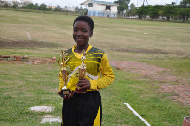 St Stephen's' Odelli Straughn displaying her MVP and Best Goal-Keeper accolades following her team's win over Stella Maris