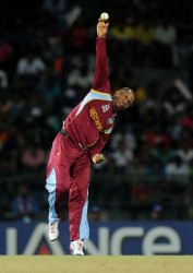 Part-time off-spinner Marlon Samuels has been banned from bowling in international cricket
