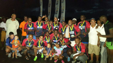 The victorious Pepsi Hornets outfit pose with the coveted Gtt 10a championship trophy.