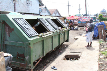 The garbage skips now occupying the vendors' former spots