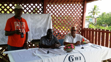 GWI Chief Executive Richard Van West-Charles (right) with Executive Director of Operations, GWI, Joseph Codette and Chairman of the Barnwell North Farmers Group, Samuel Joyce. (GWI photo)
