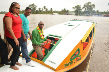 President David Granger commissioning the 'David G' V, yesterday, as Kumar Lallbachan, who donated the boat, and his wife Hardai Lallbachan look on. (Ministry of the Presidency photo)
