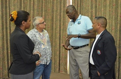 WICB director and legendary former fast bowler, Joel Garner (second from right) chats with senior counsel Anthony Astaphan during the Directors meeting while Corporate Secretary, Verlyn Faustin (left) and another WICB director, Anand Sanasie listen on. (Photo courtesy WICB)