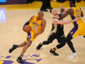 Los Angeles Lakers forward Kobe Bryant (24) moves the ball as center Roy Hibbert (17) provides a screen against Utah Jazz forward Gordon Hayward (20) during the second half at Staples Center. Gary A. Vasquez-USA TODAY Sports